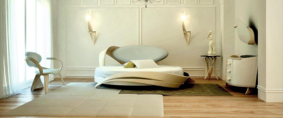 Интерьер спальной с круглой кроватью в классическом стиле