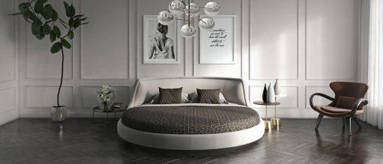 Интерьер белой спальни с круглой кроватью