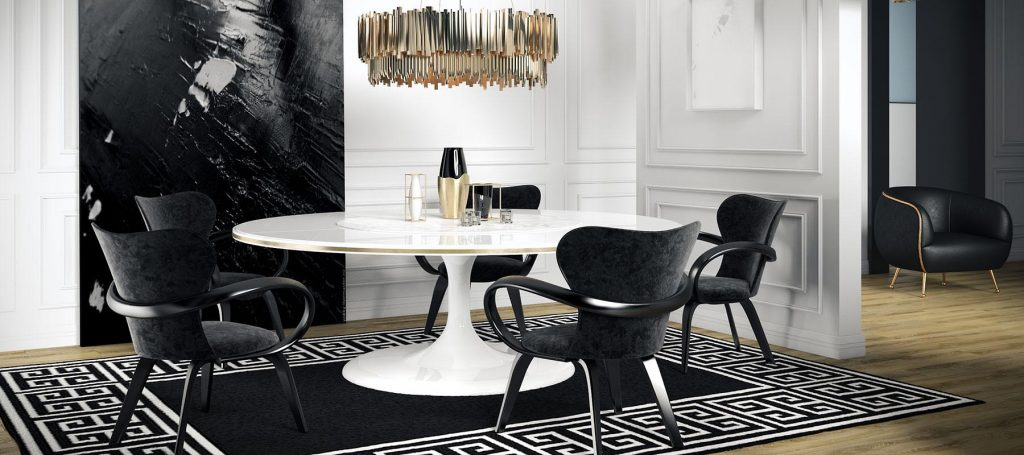 Белый обеденный стол в интерьере черной кухни