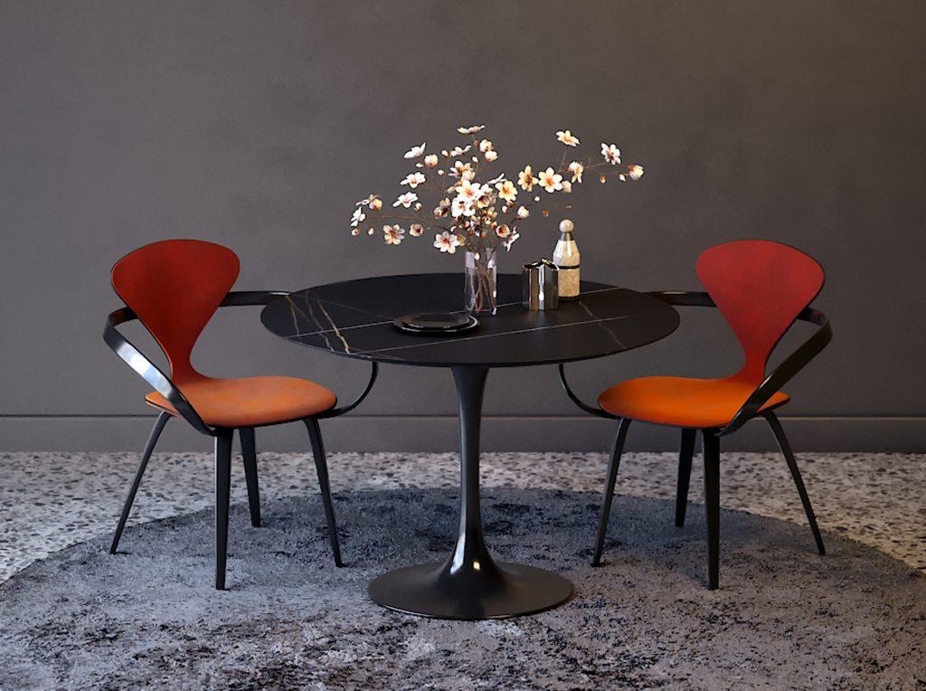 Черный обеденный стол с красными стульями